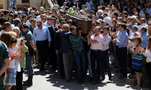 Relatives carry Víctor Barrio's coffin during his funeral in Sepulveda, Spain, on Monday.
