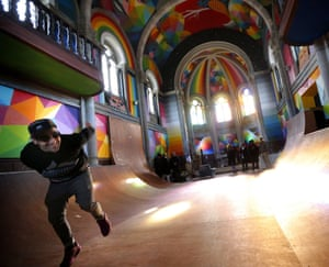Spanish artist Okuda San Miguel poses for a picture in a former Civil War's arsenal installed at the demystified Santa Barbara church in Oviedo, Asturias, Spain.