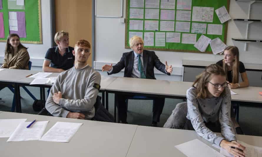 Boris Johnson sits in on a class at Castle Rock school in Coalville