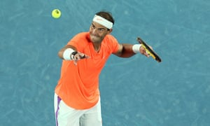 Rafael Nadal hits a ball into the crowd after after winning match point.
