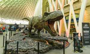 A dinosaur promotes the 2015 movie Jurassic World, at the Kings Cross Station concourse, London.