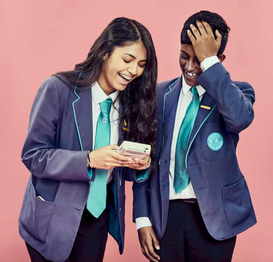 Rhianna and Jannugan with a Game Boy