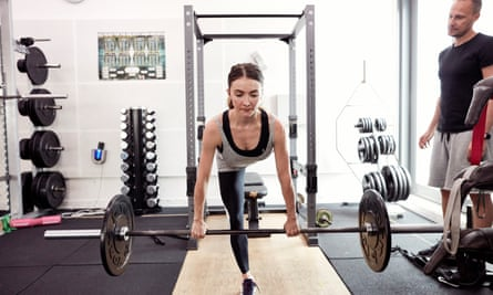 Heavy lifter: Claire Calvert working with weights.