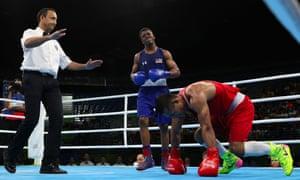 Gary Russell (blue) lost his bout despite knocking down Fazliddin Gaibnazarov of Uzbekistan