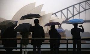 Tourists taking photos of Opera House