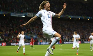 Birkir Bjarnason celebrates scoring the equaliser.