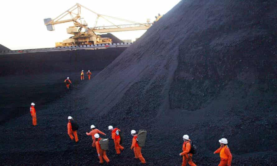 Greenpeace activists attempting to disrupt coal loading at Newcastle, the world's largest coal port