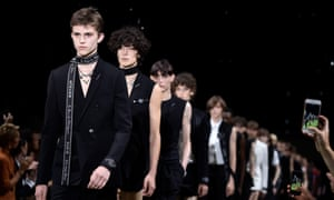 Models walk the runway during the Dior Homme Menswear spring/summer 2018 show on 24 June