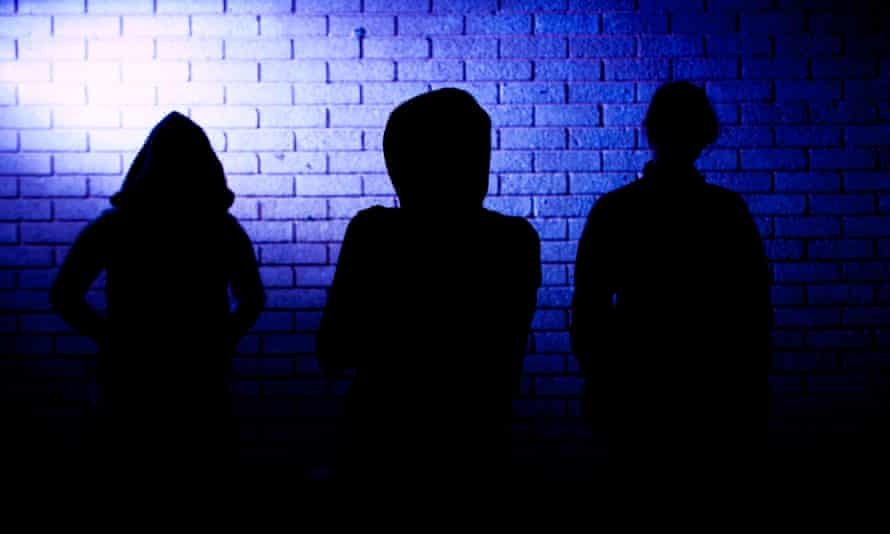 Silhouettes of three teenagers
