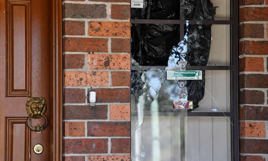 A window damaged by gunfire at the home of Stacey Taylor in Quakers Road, Marayong