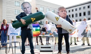 Activists wear masks of Donald Trump and Vladimir Putin holding mock nuclear missiles as they demonstrate against the ending of the Intermediate-Range Nuclear Forces Treaty (INF) in front of the American Embassy in Berlin, Germany.