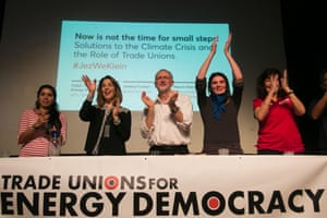 A panel of speakers, including Jeremy Corbyn and Naomi Klein, speaking at the Trade Unions for Energy Democracy (TUED) event in the Salle Olympe de Gouges, Paris, 2015.