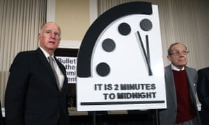 The former California governor Jerry Brown, left, and former US secretary of defence William Perry unveil the Doomsday Clock in Washington DC on Thursday.