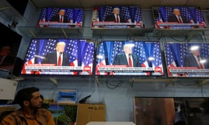 An Afghan man watches the TV broadcast of Donald Trump's speech, in Kabul.