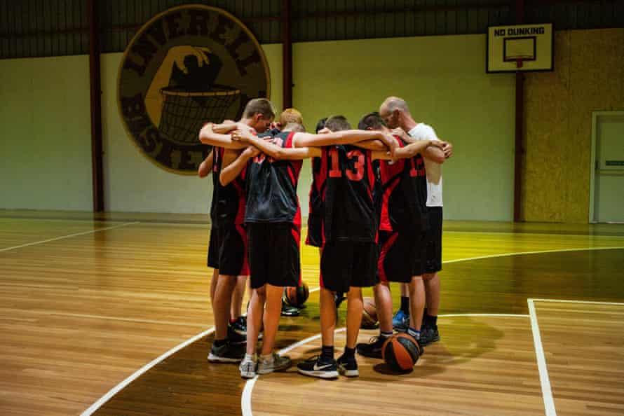 High School BBall team pray before a game, Australia