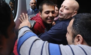 Jan Ghazi, (front right) greets his nephew Haris (centre) who arrived from in the UK today after leaving the Calais Jungle Camp, in Croydon.