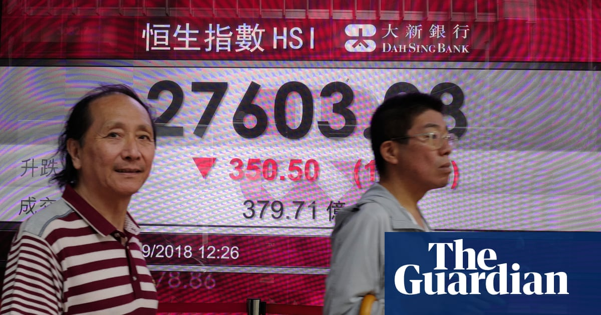 Trade war: US is putting a knife to China's neck, says top official | Business | The Guardian