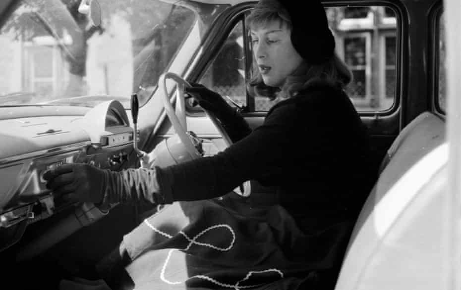 Roberta Cowell in her car, 1958. Cowell, a former racing driver and RAF pilot, was the first person to undergo gender reassignment surgery in the UK.
