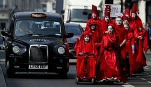 People in red walking on road