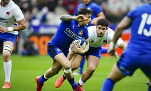 Italy's Matteo Minozzi (centre) looks for space in February's Six Nations game against France. The two countries are expected to be joined by Scotland and Japan for the one-off eight-team competition.