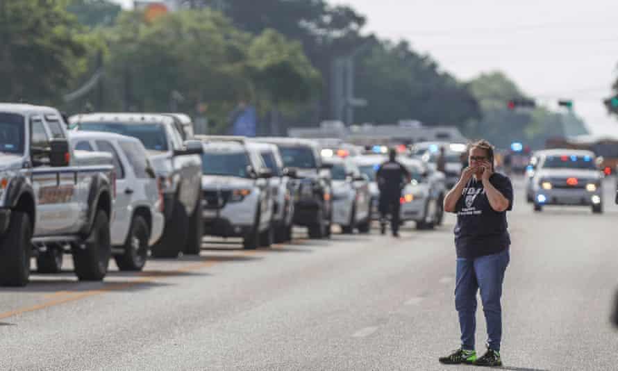 A women talks on her phone following a shooting at Santa Fe High School Friday in Santa Fe, Texas.