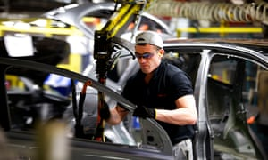Worker on car assembly line