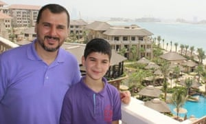 Salim Alaradi with one of his sons.