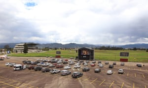 Aerial picture showing Catholic devotees in their cars attending the drive-in in a parking lot in Bogota, Colombia.
