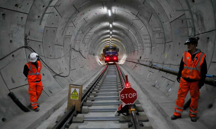 Workers laying railway track in a tunnel of the Crossrail project in Stepney, east London, in November 2016.