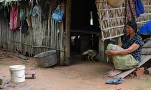 This photo taken on 15 October 2020 shows Roeurm Reth, who owes huge micro-financing debts, sitting outside her house at a village in Siem Reap province, Cambodia.