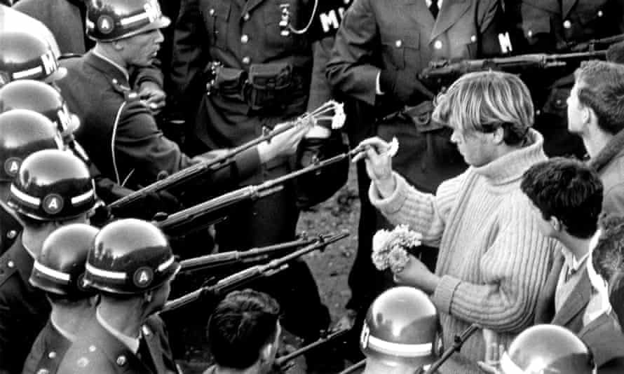 Antiwar demonstrators tried flower power on MPs blocking the Pentagon Building