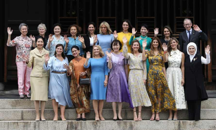 Awkward: Philip May, back right, poses with the other all-female spouses of world leaders at the G20 summit in Kyoto in 2019.