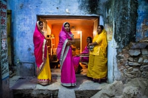 By Jason Pemberton. Women, beautifully dressed to attend a wedding, gather outside a house in Bundi, Rajasthan, India.