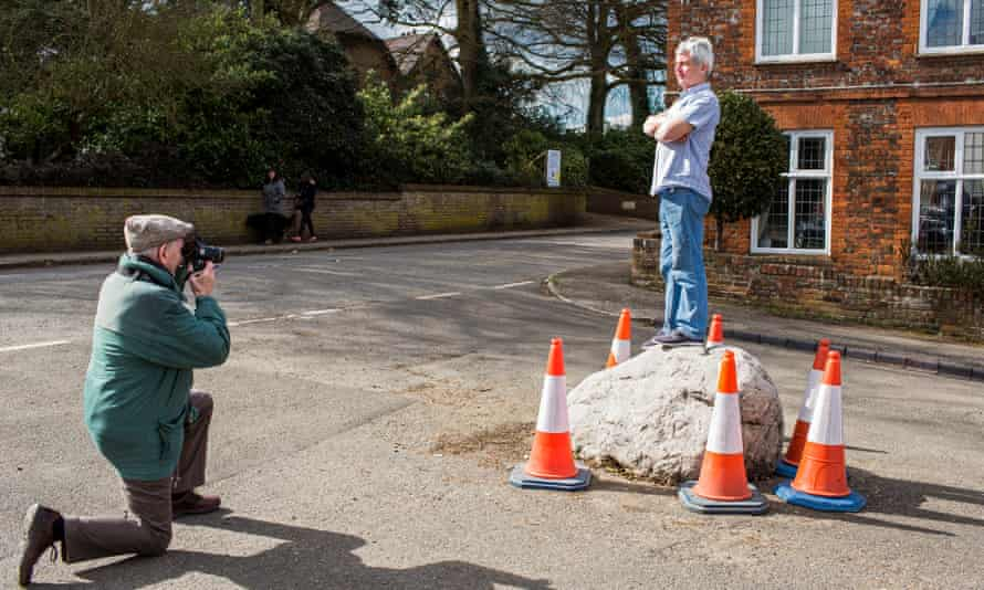 'The Soulbury stone never loses' … Victor Wright, chair of the parish council, stands on the stone in Chapel Hill.