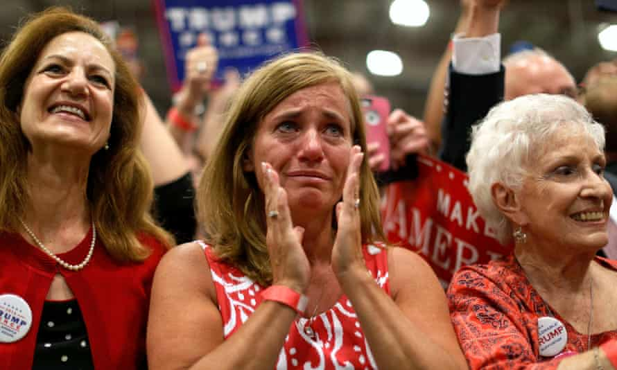A woman is moved to tears as Trump takes the stage at a campaign rally in Newtown, Pennsylvania.