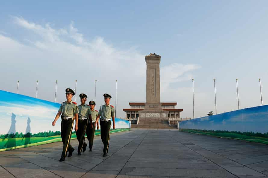 Paramilitary policemen patrol Tiananmen Square as 3 September preparations take place.