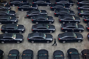 Cars parked outside the Great Hall of the People