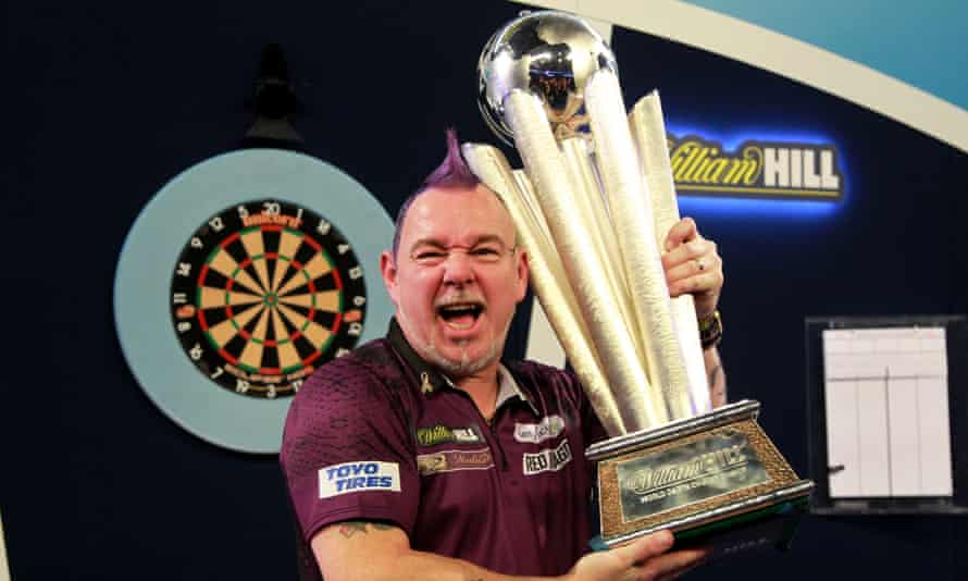 PDC World Darts Championshipepaselect epa08098305 Scottish player Peter Wright poses with his trophy after winning the PDC World darts Final match against Michael van Gerwen at the Alexander Palace in North London, Britain, 01 January 2020. EPA/SEAN DEMPSEY