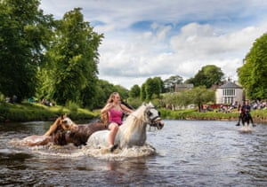 Appleby, EnglandA rider wades through water at the local Horse Fair. The event in Cumbria has existed under the protection of a charter granted by James II since 1685. It is one of the key meeting points for members of the Gypsy, Romany and travelling communities.
