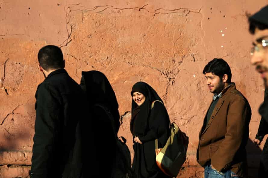 Iranians make their way along Enghelab-e Islami (Islamic Revolution) Street in Tehran.