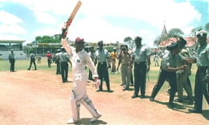 Brian Lara celebrates beating Sir Garfield Sobers' Test record score in his innings of 375 against England in Antigua in 1994.