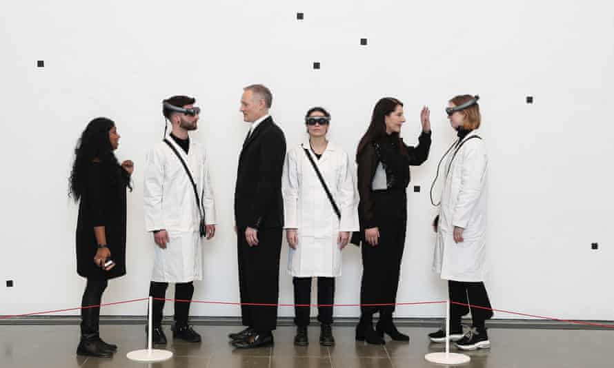 She was never really there … Marina Abramović (second right) poses ahead of her exhibition.