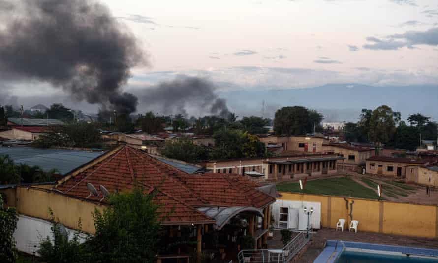 Smoke rises from buildings near Bujumbura as clashes continue