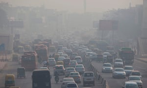 Indian commuters drive amidst heavy smog along a busy road in New Delhi.