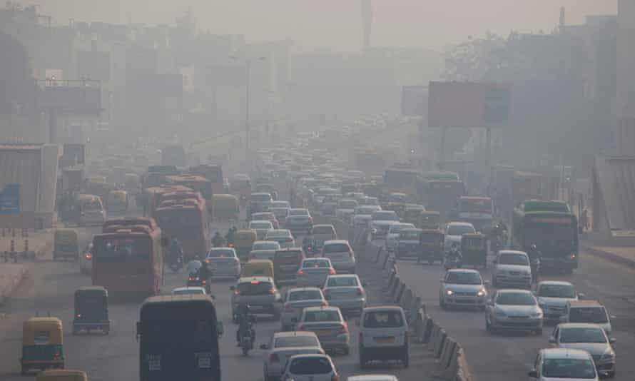Heavy smog hangs over along a busy road in New Delhi.