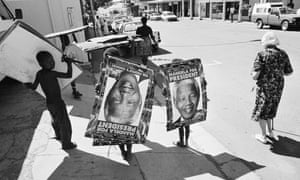 Children in the Orange Free State put up posters of the ANC's leader Nelson Mandela, in the run-up to South Africa's first democratic elections in 1994