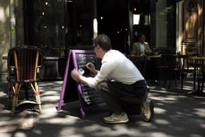 A restaurateur prepares to reopen in the 9th arrondissement of Paris as bars and restaurants return after more than two months of nationwide restrictions