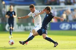 John Swift tackles Slovakia's Martin Chrien.