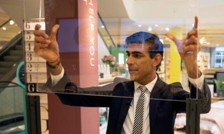 Rishi Sunak visits a John Lewis department store in June.