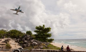 A plane takes off from the island of Nauru.